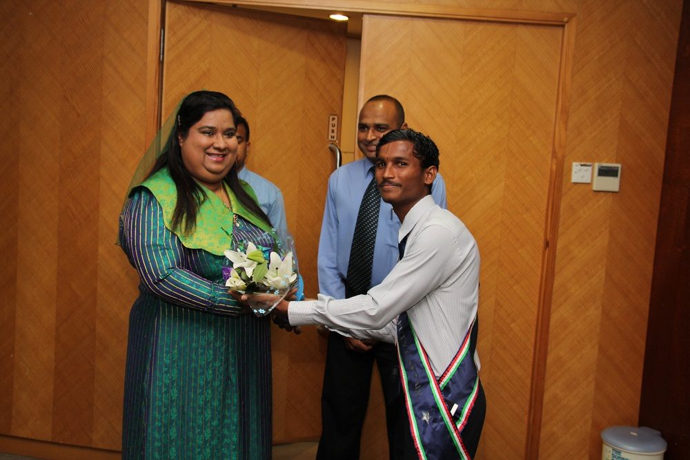 Welcome bouquet being handed over to the chief guest Dr. Aamaal Ali.