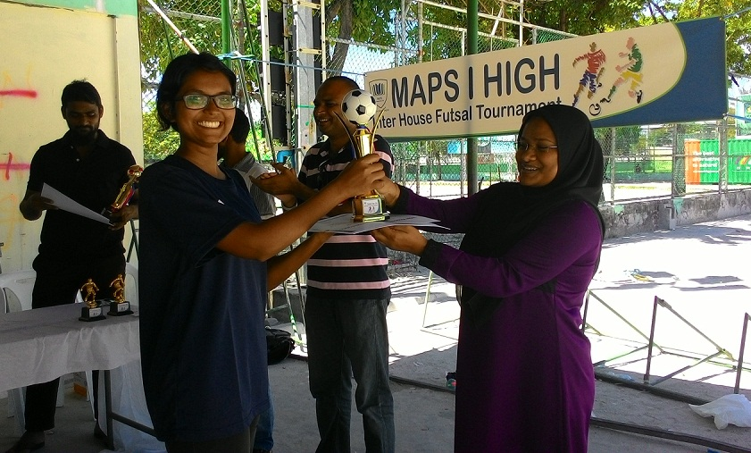 Girls' Champions trophy being handed over to Achievers house captain.